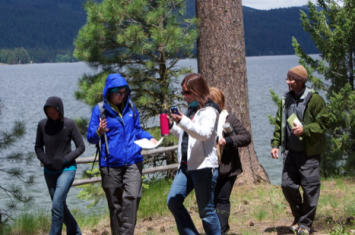 Image 1: Teachers moving to the next checkpoint with their thermos of hot water and pine needles.