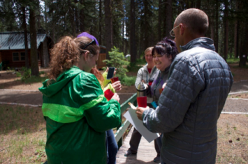 Image 2: Teachers preparing to drink their pine tea.