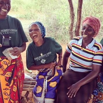 Photo 3: The Neema women's group celebrates when they learn that they will receive loans for water tanks.