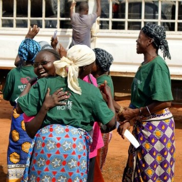 Photo 4: The Neema women's group celebrates as their water tanks arrive.