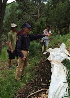 Jerome and students working with a hugelkultured swale at CRMPI