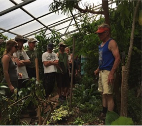 Jerome and students inside the Phoenix greenhouse at CRMPI.