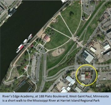 Figure 1. River's Edge Academy is located walking distance to a  park by the Mississippi River.