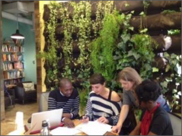 Figure 7. The writing collective at SERI with the living wall in the background.